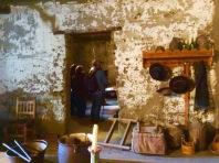 Kitchen area looking to the doorway into the bedroom