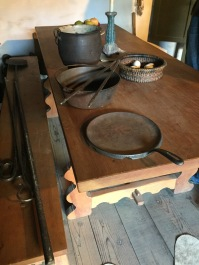 Kitchen table and typical tools including cast iron pot and griddle